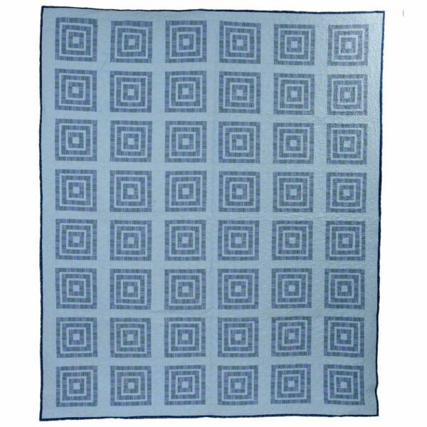 Nested Boxes Quilt is comprised of nesting squares of blue solid and blue stripe fabrics