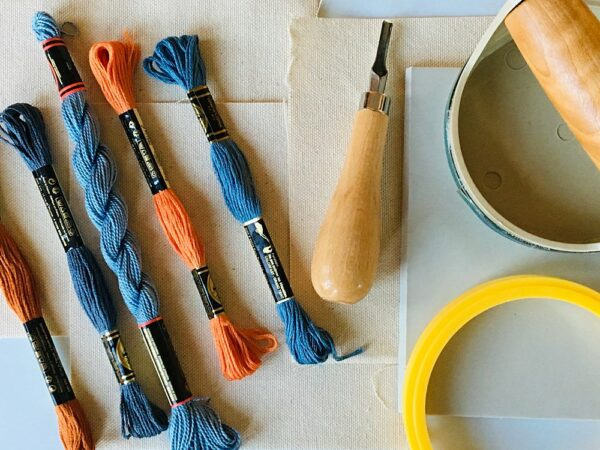 Embroidery floss, hoops, and block printing tools