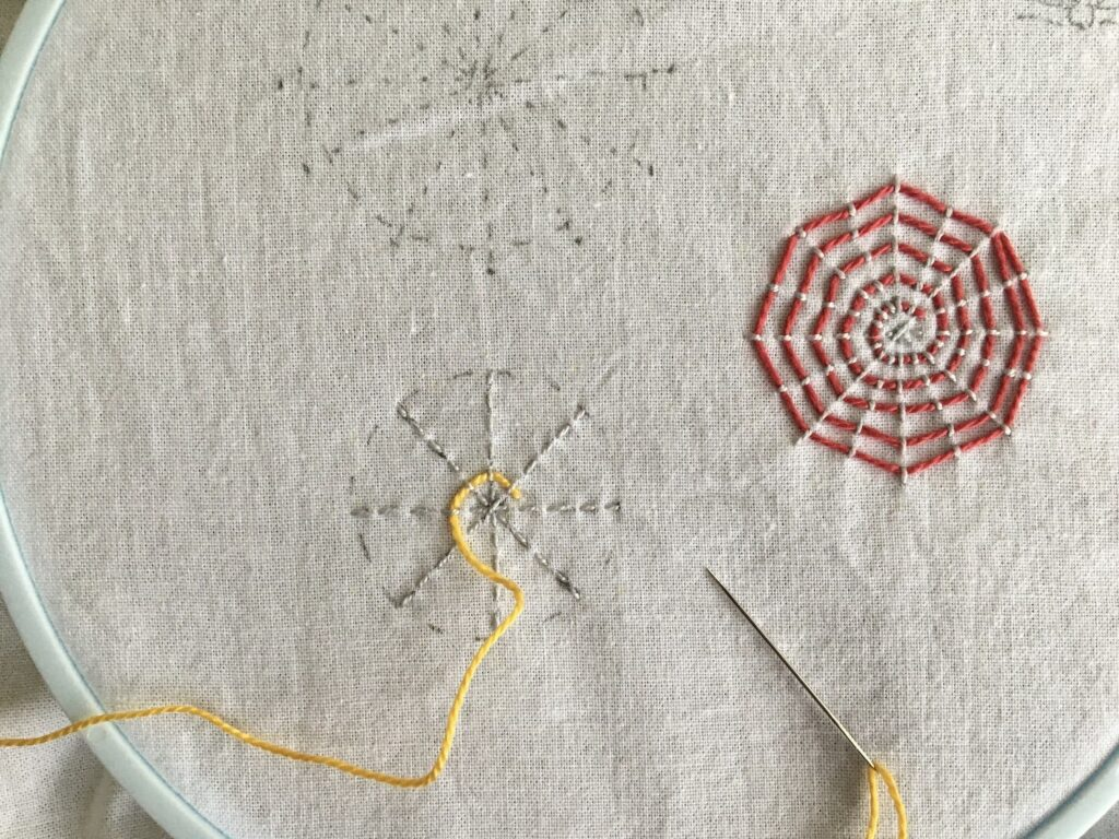 Closeup of Colorful Webs Embroidery Project