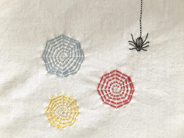 Colorful Webs Embroidery Project featuring three spider webs and one spider
