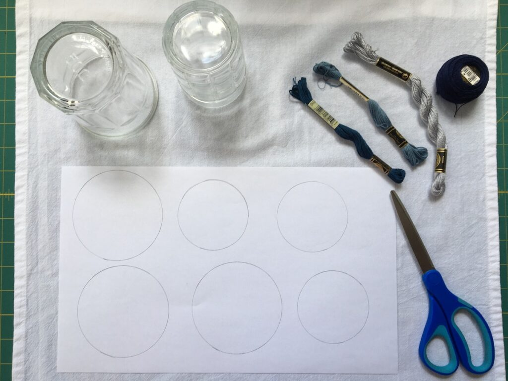 Supplies needed to stitch soap bubble dish towel project - including threads, scissors, circle shapes