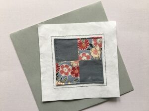 Quilt block stitched to white Tyvek Envelope