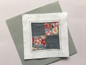 Quilt block stitched to white Tyvek Envelope