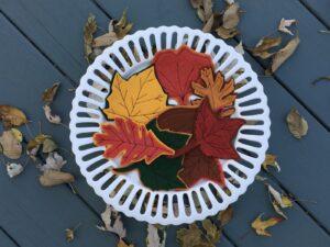 Felt leaves on white cake stand
