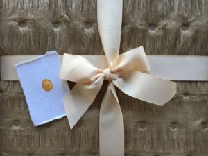 Unwrapped package with notecard