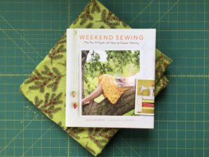 Green flannel with pine and berry print and the book Weekend Sewing by Heather Ross