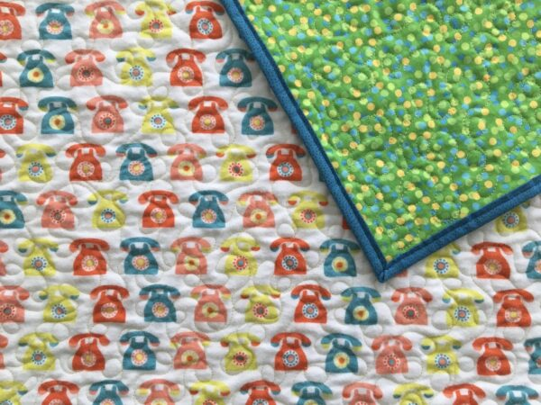 Whole Cloth quilt with Retro Phone Print on Front and Polka Dots on Back
