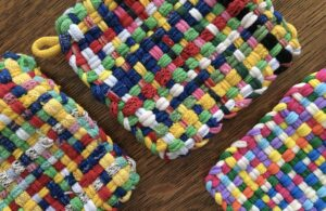 Potholders made with colorful loops and loom