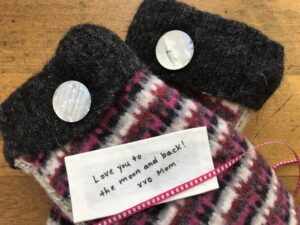 Handmade cotton clothing label laying on mittens