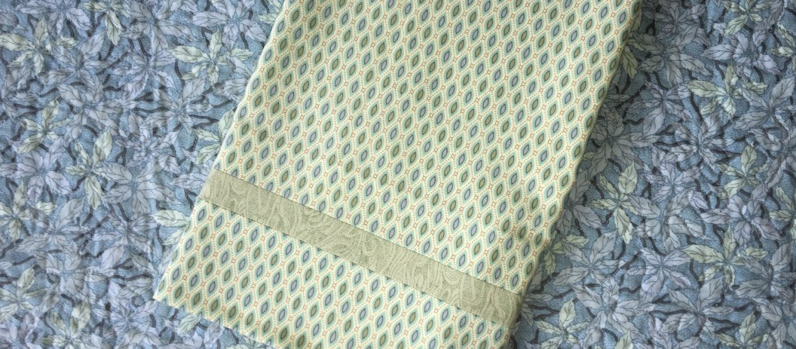 Yvonne Malone Studio Make in a Day Pillowcase folded on top of quilt